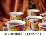 cups of tea on the background... | Shutterstock . vector #761997445