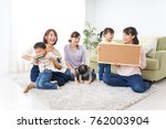 child having a board with mother | Shutterstock . vector #762003904