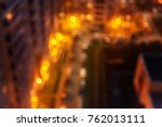 blured urban buildings at night | Shutterstock . vector #762013111
