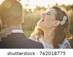 a young bride laughs and yells... | Shutterstock . vector #762018775