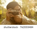 photographer with vintage photo ... | Shutterstock . vector #762033484