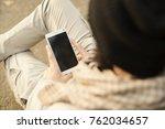 modern man using smart phone | Shutterstock . vector #762034657