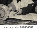 Small photo of Reading a Torah scroll during a bar mitzvah ceremony with a traditional yad pointing towards the text on the parchment.