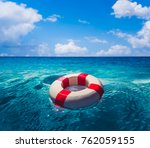 life saver ring floating in the ... | Shutterstock . vector #762059155