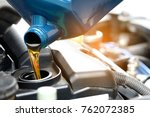 refueling and pouring oil... | Shutterstock . vector #762072385