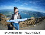 young female tourist looking... | Shutterstock . vector #762075325