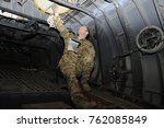 Small photo of Staff Sgt. Vincent Telmanik, 774th Expeditionary Airlift Squadron loadmaster, performs a pre-flight inspection of a C-130 Hercules cargo aircraft on Bagram Airfield, Afghanistan, April 23, 2013