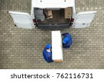 two young delivery men in... | Shutterstock . vector #762116731