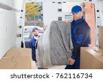 two happy male movers in... | Shutterstock . vector #762116734