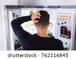 rear view of a confused young... | Shutterstock . vector #762116845
