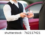 close up of valet's hand giving ...   Shutterstock . vector #762117421