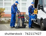 two young male janitor in blue... | Shutterstock . vector #762117427