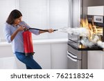 young woman using fire... | Shutterstock . vector #762118324