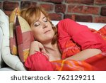 middle aged woman sleeps on the ... | Shutterstock . vector #762129211