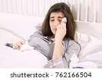 unhappy woman touching head... | Shutterstock . vector #762166504