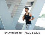 man running and listening music ... | Shutterstock . vector #762211321