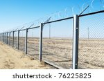 fence with barbed wire on a... | Shutterstock . vector #76225825