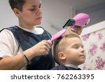 female hairdresser drying boy's ...   Shutterstock . vector #762263395