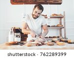 baker with a variety of healthy ... | Shutterstock . vector #762289399