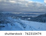 winter rime and snow covered... | Shutterstock . vector #762310474