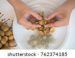 peeling longan fruits by hands | Shutterstock . vector #762374185