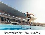 runner jumping over an hurdle... | Shutterstock . vector #762383257