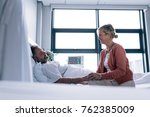 woman visiting husband in... | Shutterstock . vector #762385009