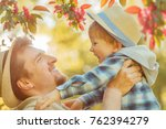 father and son on a walk in the ... | Shutterstock . vector #762394279