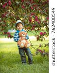 boy in the park and with a... | Shutterstock . vector #762400549