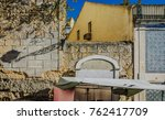 old and textured facade in... | Shutterstock . vector #762417709