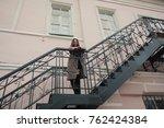business woman walking on street | Shutterstock . vector #762424384