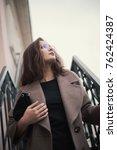 business woman walking on street | Shutterstock . vector #762424387