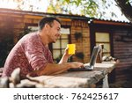 men sitting in the at backyard... | Shutterstock . vector #762425617
