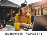 women wearing yellow shirt... | Shutterstock . vector #762425641