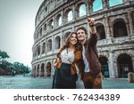 young couple at the colosseum ... | Shutterstock . vector #762434389
