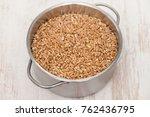 uncooked spelt in pot on wooden ... | Shutterstock . vector #762436795