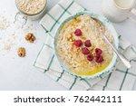 oatmeal porridge with fresh... | Shutterstock . vector #762442111