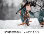 hunter in camouflage with rifle ...   Shutterstock . vector #762445771