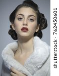 Small photo of Vintage portrait of girl wearing a white fur coat posing as a hollywood diva from the 1950's