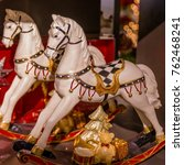 Small photo of White Carousel horse statues with Christmas tree, teddy bear and gifts