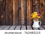 white pitcher holding a bouquet ...   Shutterstock . vector #762485215