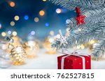 red gift box under silver...   Shutterstock . vector #762527815