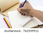men s hands writing in notebook. | Shutterstock . vector #762539911
