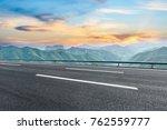 asphalt highway and mountain...   Shutterstock . vector #762559777