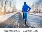 runner stretching in winter... | Shutterstock . vector #762581335