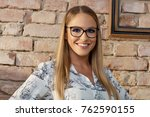 portrait of a smart young woman ... | Shutterstock . vector #762590155