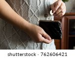 the woman holds the coins over... | Shutterstock . vector #762606421
