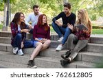 group of young people with... | Shutterstock . vector #762612805