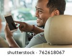 happy taxi driver showing... | Shutterstock . vector #762618067