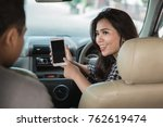 portrait of young female taxi... | Shutterstock . vector #762619474